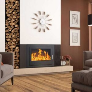 A Henley Faro 700 Boiler Stove on a cream mantel with a warm red background and timber logs.