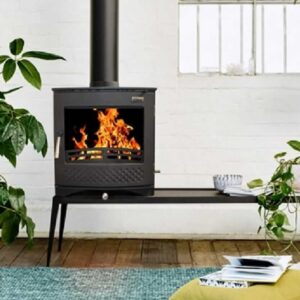 Hamco Stockholm Stove in a cool living room surrounded by a fake potting plant